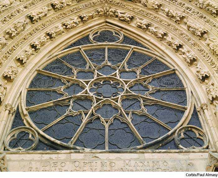 A Large Circular Window Usually Glazed With Stained Glass Having Stone Tracery Radiating From The Center Often Intricate Petallike Patterns